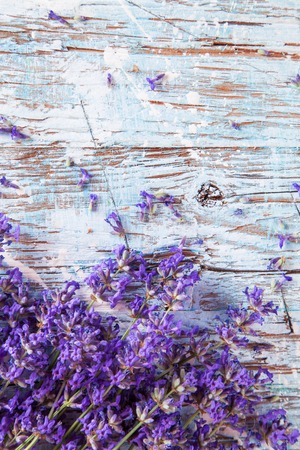 Lavender blossoms on wood, shot from upper view photo