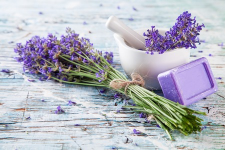 wood products: Lavender bunch with soap and grinder on white wood Stock Photo