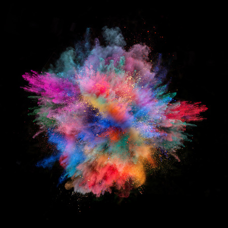 color: Freeze motion of colored dust explosion isolated on black background Stock Photo
