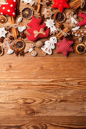 christmas cake: Traditional gingerbread hanging on wooden background Stock Photo