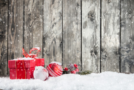 Christmas still life with gifts and balls. Wooden planks as background