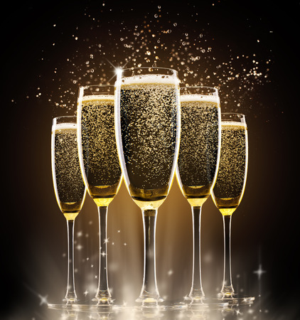 Collection of glasses of champagne on black background