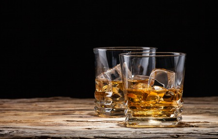 Whiskey drinks on wooden planks
