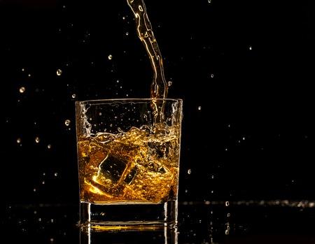 dark glasses: Whiskey drink on black background