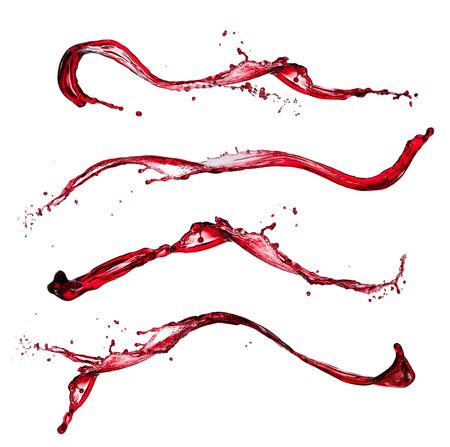 liquido: Salpicaduras de vino rojo sobre fondo blanco