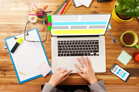 using laptop: Woman working on laptop.
