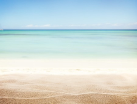 Sandy beach with blur sea on background Foto de archivo