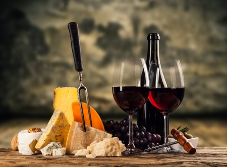 Various kind of cheese with red wine Stock Photo