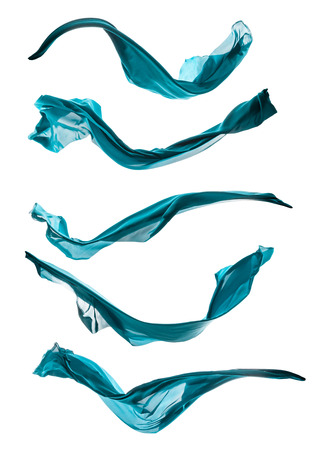 Isolated shot of freeze motion of blue silk, isolated on white background