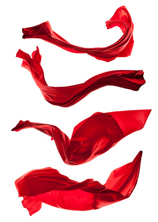 Isolated shot of freeze motion of red silk, isolated on white background