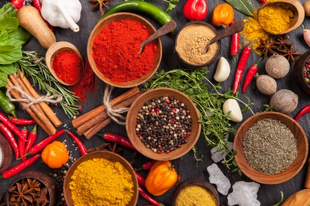 Various spices on black stone shot from aerial view Imagens - 37887022