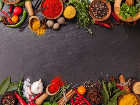 Various spices on black stone shot from aerial view Imagens - 37890387