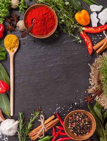 spices and herbs: Various spices on black stone shot from aerial view