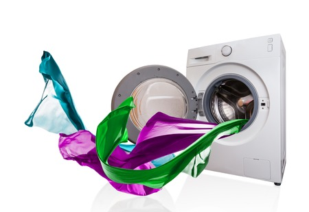 launderette: Colored cloth flying from washing machine, isolated on white background