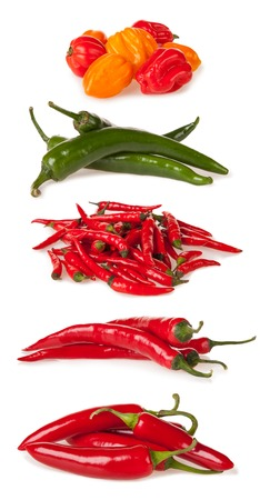 habanero: Isolated piles of various kind of chilli peppers isolated on white background