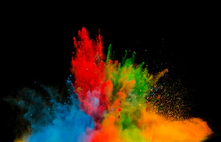 Freeze motion of colored dust explosion isolated on black  Stock Photo