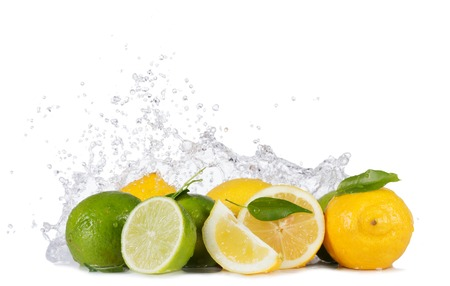 Fresh limes and lemons with water splashes isolated on white background photo
