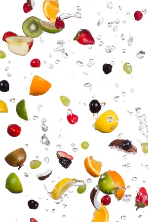 fruit in water: Mix of fruit with water splashes isolated on white background