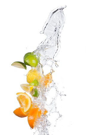 Fresh limes, lemons and oranges with water splashes isolated on white background Foto de archivo