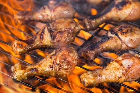 chicken grill: Chicken legs on grill