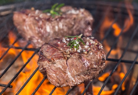charcoal grill: Beef burger on grill Stock Photo