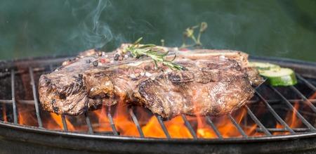 t bone: Beef steak on grill