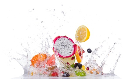 Fruits in water splash isolated on white background Foto de archivo