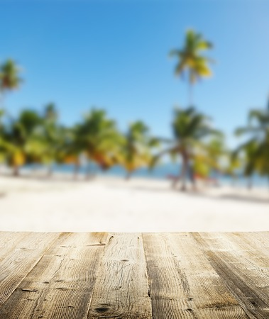 product placement: Empty wooden pier with view on sandy beach. Free space for text or product placement