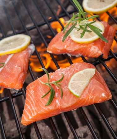barbequing: Delicious grilled salmon steaks on fire Stock Photo