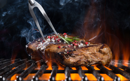 Beef steak on grill, isolated on black background Reklamní fotografie - 40285074