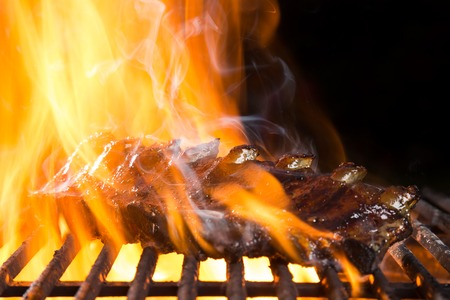 Ribs on barbecue grill in flames Banco de Imagens - 40284960