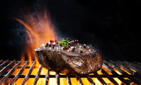 meat on grill: Beef steak on grill, isolated on black background