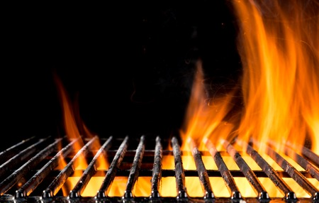 Empty grill grid with fire flames, isolated on black background