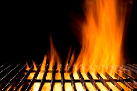 coal fire: Empty grill grid with fire flames, isolated on black background
