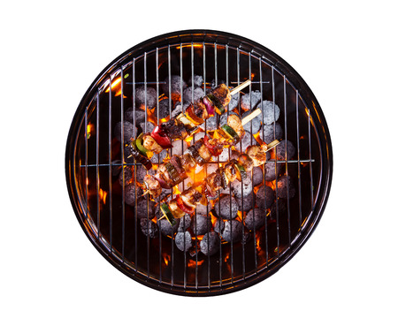 Garden grill with skewers, isolated on white background Stock Photo