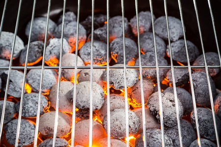 briquettes: Burning grill briquettes with clear empty grid