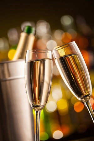 Celebration theme with two glasses of champagne. Blur bottles on background Stock Photo