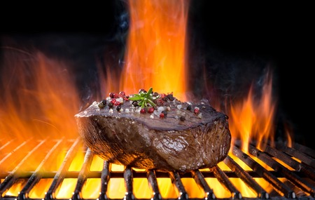 steak beef: Beef steak on grill, isolated on black background