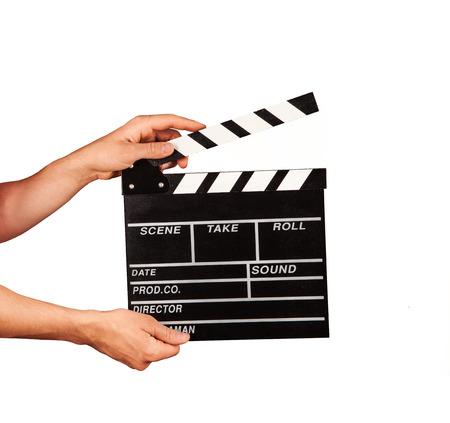 흰 배경에 고립 된 영화 클래퍼를 들고 남자 손 스톡 콘텐츠