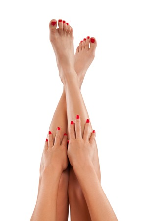 bare women: Perfect female legs and hands, isolated on white background Stock Photo