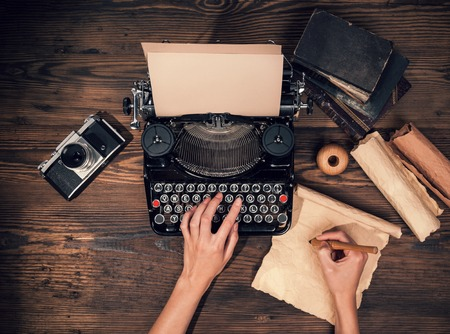 Retro typewriter placed on wooden planks. Aerial angle of view