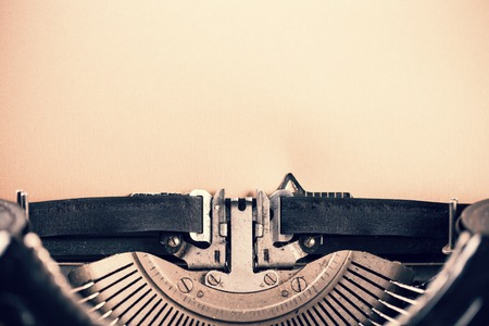typewriter key: Detail of vintage typewriter with blank paper for text Stock Photo