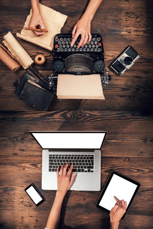 type: Old typewriter with laptop, concept of technology progress Stock Photo