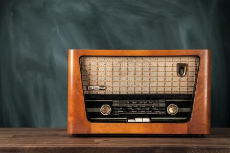 retro radio: Old retro radio on wooden table Stock Photo
