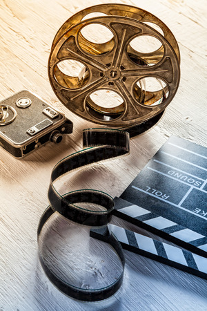 video camera: Film camera chalkboard, vintage camera and roll on wooden table Stock Photo