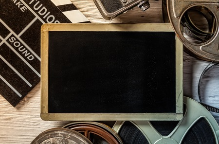 Retro film accessories with blank blackboard for copyspace