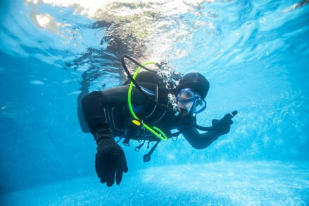Full equiped diver in swimming pool