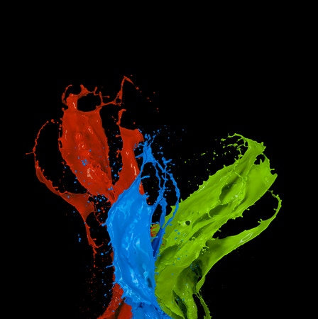 color background: Colored paint splashes isolated on black background