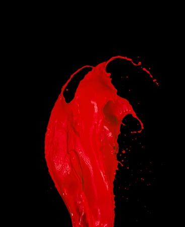 Red paint splash isolated on black background
