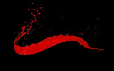 Rode verf splash geïsoleerd op een zwarte achtergrond Stockfoto
